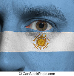 face with the Argentinian flag painted on it