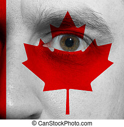 face with the Canadian flag painted on it