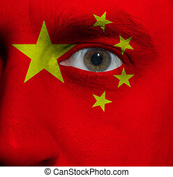 face with the Chinese flag painted on it