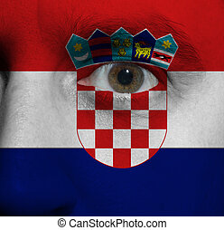 face with the Croatian flag painted on it