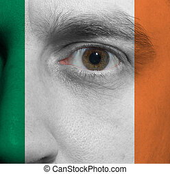 face with the Irish flag painted on it - close-up of a face...