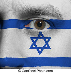 face with the Israeli flag painted on it