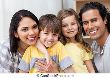 Close-up of a family hugging in the kitchen