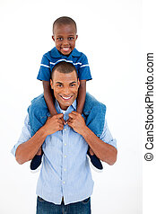 Close-up of a father giving son piggyback ride