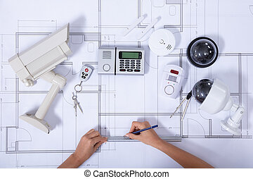 Female Architect Drawing Blueprint With Pencil