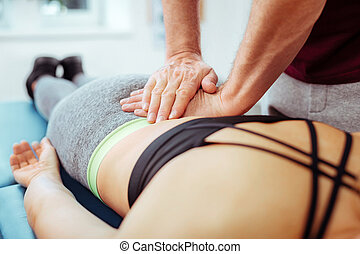 Close up of a female back during the massage