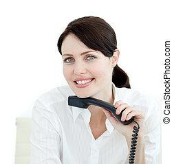 Close-up of a female executive holding a phone