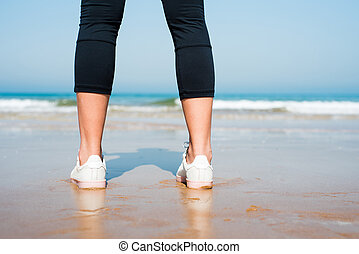 Close up of a female jogger on the beach