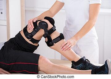 Physiotherapist Giving Leg Exercise