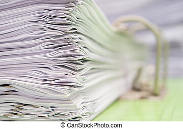 close up of a file holder with documents