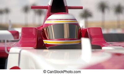 Close-up of a formula one race car driver