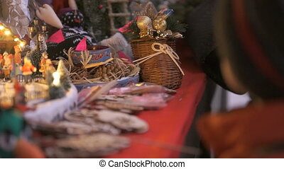 Close-up of a gift shop at Christmas. The buyer chooses a...