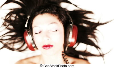 close-up of a girl listening to music on headphones