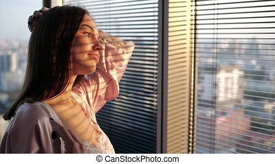 close up of a girl looking out the window