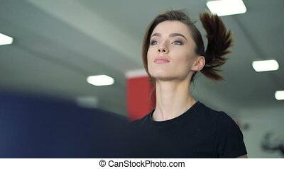 Close-up of a girl running on a treadmill. 4k
