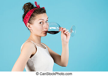 Close-up of a girl with a glass of wine