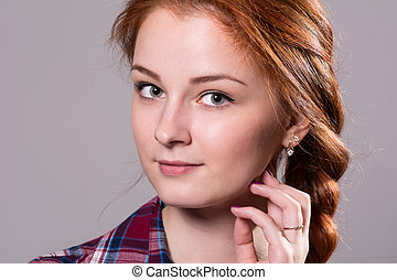 Close-up of a girl with pigtails looking at the camera.
