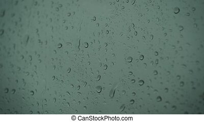 Close up of a glass with water drops while outside is ...