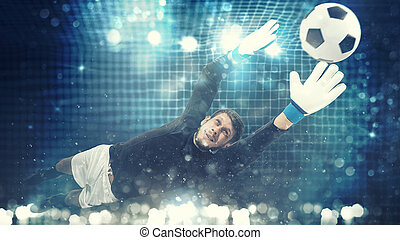Close up of a goalkeeper dives to save a shot aimed at the goal with light effects