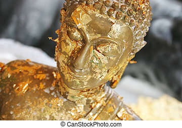 Buddhist statue - Close-up of a gold Buddhist statue in...