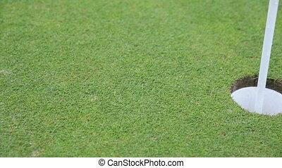 close up of a golf hole