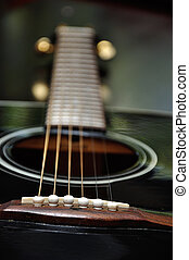 Close up of a guitar with shallow depth of field