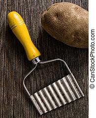 close up of a hand crinkle cut potato chipper