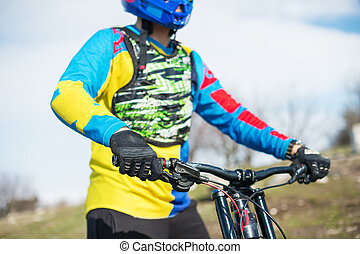 Close-up of a hand Man racer mtb cyclist in sport gloves getting ready for a race firmly holds the steering wheel