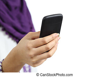 Close up of a hand of arab woman using a smart phone...