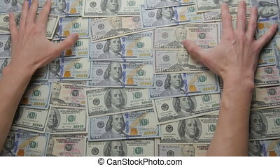 Close-up of a hand take out dollar bills. The concept of...