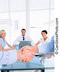 Close-up of a handshake in business meeting