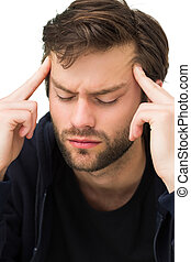 Close-up of a handsome young man with headache