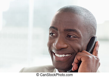 Close up of a happy businessman on the phone