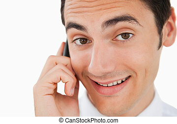 Close-up of a happy man calling with his cellphone