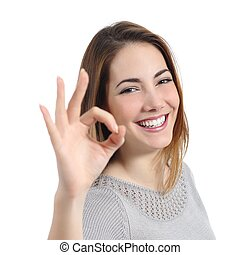 Close up of a happy woman with perfect smile gesturing ok
