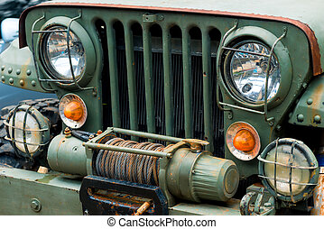 close-up of a headlight of an old military car