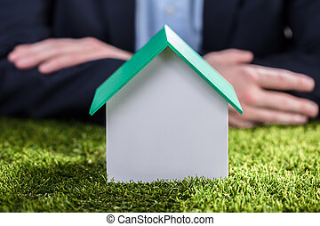 Close-up Of A House Model On Green Grass