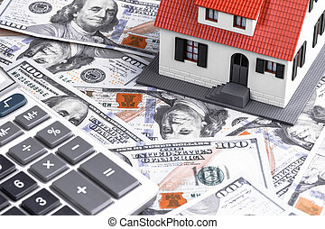 Close-up of a House Model with Calculator on Dollar Notes