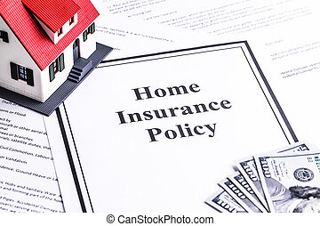 Close-up of a House Model with Home Insurance Policy on Dollar Notes