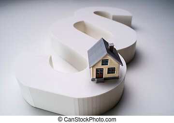 Close-up Of A House Model With Paragraph Symbol