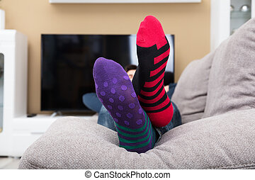 Close-up Of A Human Feet With Socks