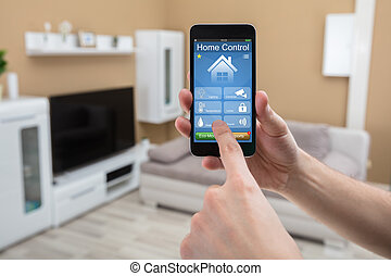 Mobile Phone With Home Control System On Screen