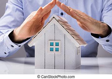 Human Hand Protecting House Model