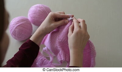 Close up of a knitting process