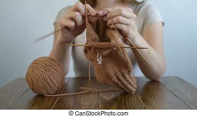 Close up of a knitting woman