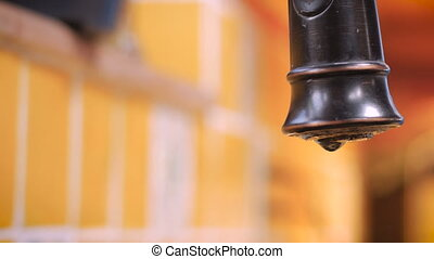 Close up of a leaky faucet dripping and wasting water- ROOM...