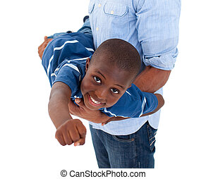 Close-up of a little boy having fun with his father