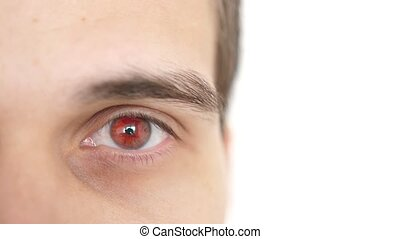Close up of a male eye. Detail of a red eye of a man looking...