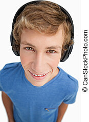 Close-up of a male student wearing headphones