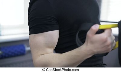 Close up of a man doing one arm push ups with gymnastic...